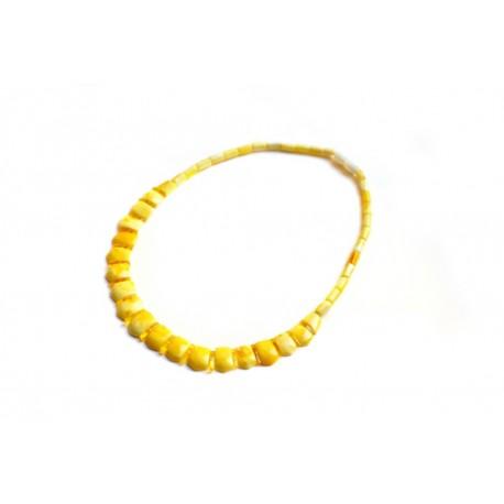 Matinis geltonos spalvos koljė kampuotais, užapvalintais kraštais