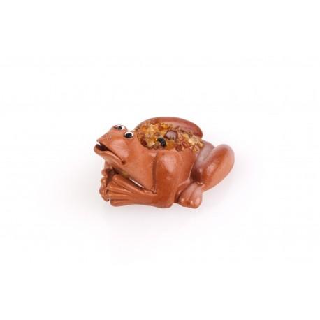 Gintaru dekoruota keramikinė varlytė